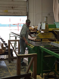 Man working on floor trusses assembly