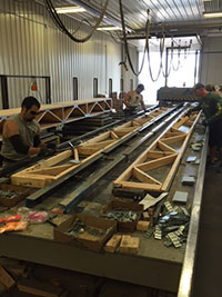 Men building custom floor trusses in Minnesota